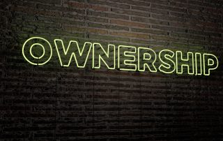OWNERSHIP -Realistic Neon Sign on Brick Wall background